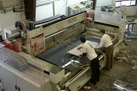 fabricators cutting granite countertop on cnc machine