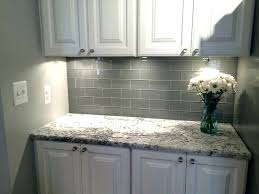 backsplash with white cabinets and grey countertop grey