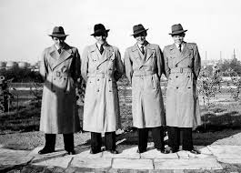 four businessmen wearing trench coats as part of their work uniform 1940 kirn vintage stock corbis