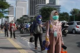 Indonesian civil servants <b>rush</b> to <b>hold</b> meetings in hotels even as ...
