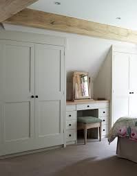 fitted wardrobes in a sloping walled country bedroom attic bedroom furniture