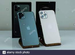iPhone 12 Pro Max in Gold next to iPhone 11 Pro Max in Midnight Green color  Stock Photo - Alamy