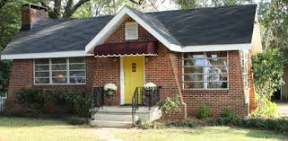 yellow brick house red door. yellow brick houses affordable red house color door