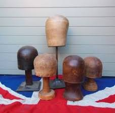 Wooden Hat Stands For Display Wooden Hat Stands at D and A Binder I These wooden hat stands are 33