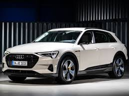 how audi s new e tron stacks up to its electric peors spec by spec