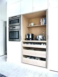 pivoting pocket door must have sliding shelves draws wall oven a good idea spare bad backs sliding door oven