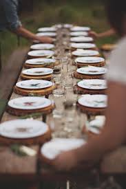 for a beautifully rustic table tree stump place mats give the table great texture and can be layered with almost any charger or plate for a cool effect