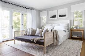 white bedroom with lots of windowedium hardwood flooring with area rug