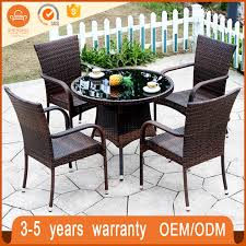 modern leisure rattan black tempered glass top round table and 4 chair dining set sh tb145