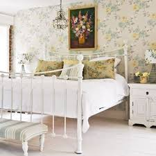 The Cast Iron Bed, Painted White, Is A Wonderful Focal Piece In This  Charming