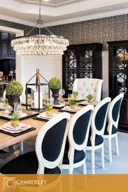 A supremely elegant crystal chandelier hangs above the Hamilton model's formal  dining room. Nature inspired centerpieces decorate the lightly stained wood  ...