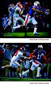 artist daniel a moore recently completed the second of a two painting series commemorating two historic plays from auburn s 2016 season of miracles