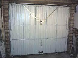 henderson garage doorInward turning doors can be rehung on new horizontally tracked