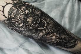 татуировка с волком на голени парня фото рисунки эскизы