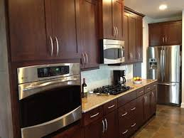 cabinet handles for dark wood. Dark Wooden Contemporary Handles For Kitchen Cabinets With Beige Countertop And Stylish Recessed Lights Cabinet Wood F