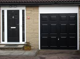 good black garage door flawless maryland unique picture design lowe photo paint with window image weather stripping on red brick house white trim uk