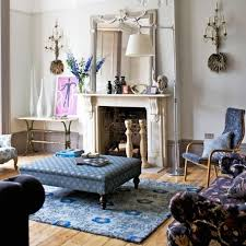 light living room with eclectic design style also blue fl rug and contrastic pattern ottoman with covered coffee table also natural wooden floor and