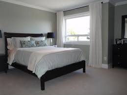white bedroom with dark furniture. grey walls white curtains dark furniture bedroom with g