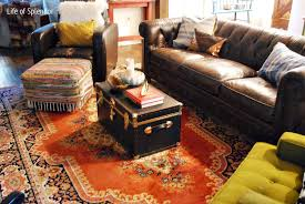 decorating ideas for living room with brown leather sofa pleasant brown sofa on red rug plus black crate in persian living room desaign 1024 685