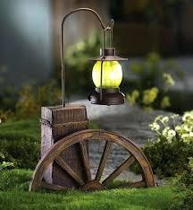 solar garden accents western wagon wheel with lighted lantern outdoor decoration light decor yard and gardens