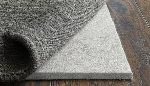 area common pads stainmaster home best rug pound pad for floors floor under felt delightful