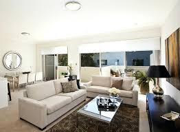 brown rug living room teal sitting room brown rug white leather