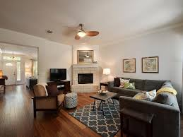L Shaped Couch Living Room Contemporary Living Room With Open Concept Stone Fireplace In