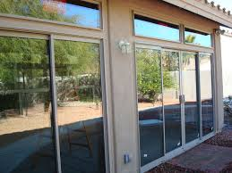 patio enclosure with sliding glass doors