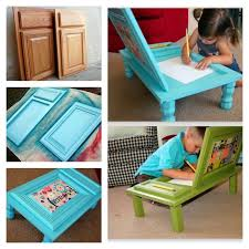 this fabulous diy project which transforms a simple cupboard door into a great art desk the desk takes up very little space and completely portable