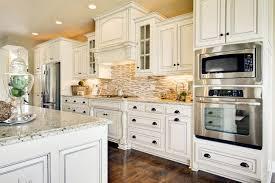 birch wood autumn yardley door rustic white kitchen cabinets backsplash shaped tile porcelain stone countertops sink