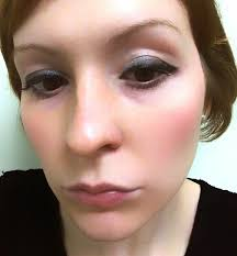 finally i apply pink blush to the apples of my cheeks brushing in an upward motion