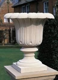 beige stone garden planter for