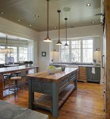 farm style kitchen island. farmhouse table style kitchen island with butchers block countertop. wooden plank ceiling. by gregory farm pinterest