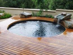 Swimming Pool:Dazzling Small Swimming Pool Design Ideas Featuring Slide  Also Stone Waterfall And Wooden