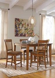 berringer dining room set with square counter table and 4 upholstered barstools in rustic