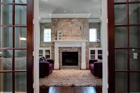 for brick fireplace wall family room traditional with crown molding tv tv