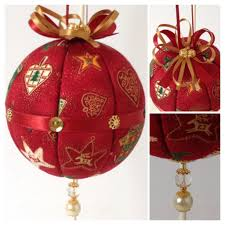 Fabric covered polystyrene bauble.