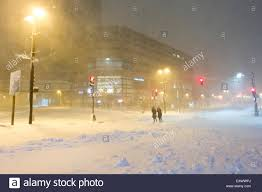 Snowfall Blizzard Lights People Fight Heavy Winds And Snowfall On A City Street