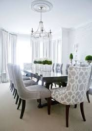 black table with green moss accents grey chairs lux decor elegant dining room with silvery gray damask wallpaper and dark hardwood floors layered