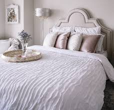 a white ruffled bedspread and pink velvet pillows second bedroom ideas with havenly and