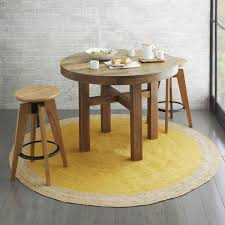 Dining Room With Round Table And Stools Also Jute Rug Natural - Dining room rug round table