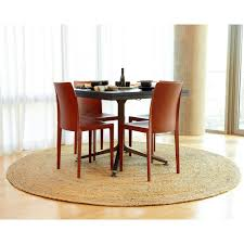 sisal area rug under round dining table