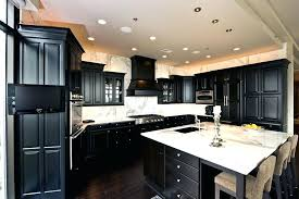 dark grey kitchen cabinets with white countertops