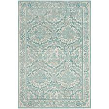 competitive teal colored area rugs safavieh evoke blue ivory 8 ft x 10 rug evk256c the