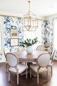 Dining room with blue floral wallpaper