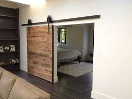 modern interior barn doors. Interior Design Sliding Barn Door Home Office Interiors With Dark Floor And White Wall,black Wall Shelves Modern Ideas Furniture Doors G