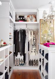 clothes rack on the center and lots of open racks on the sides for shoes and
