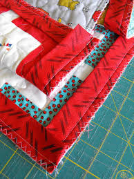 Hand Sewn Binding Tutorial & In-Process Quilt Laid out on Table Adamdwight.com