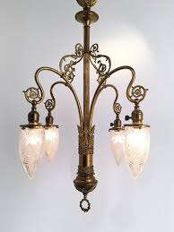 4 light art nouveau chandelier with stalactite glass shades