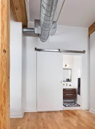toronto closet sliding doors spaces industrial with wood floor contemporary bathroom  vanities exposed beams